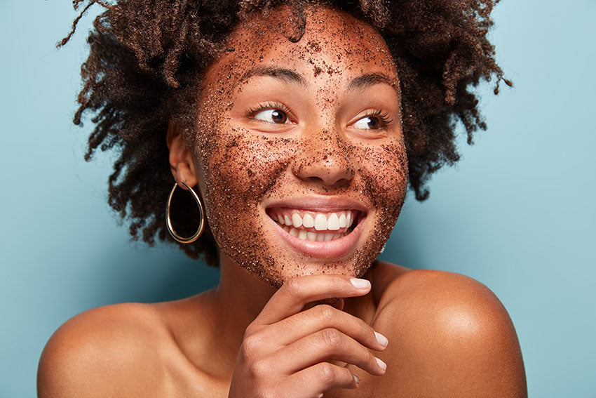 African American woman with facial scrub