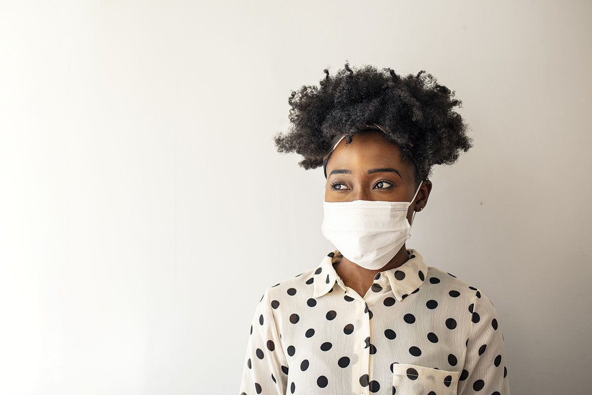 african american woman wearing mask