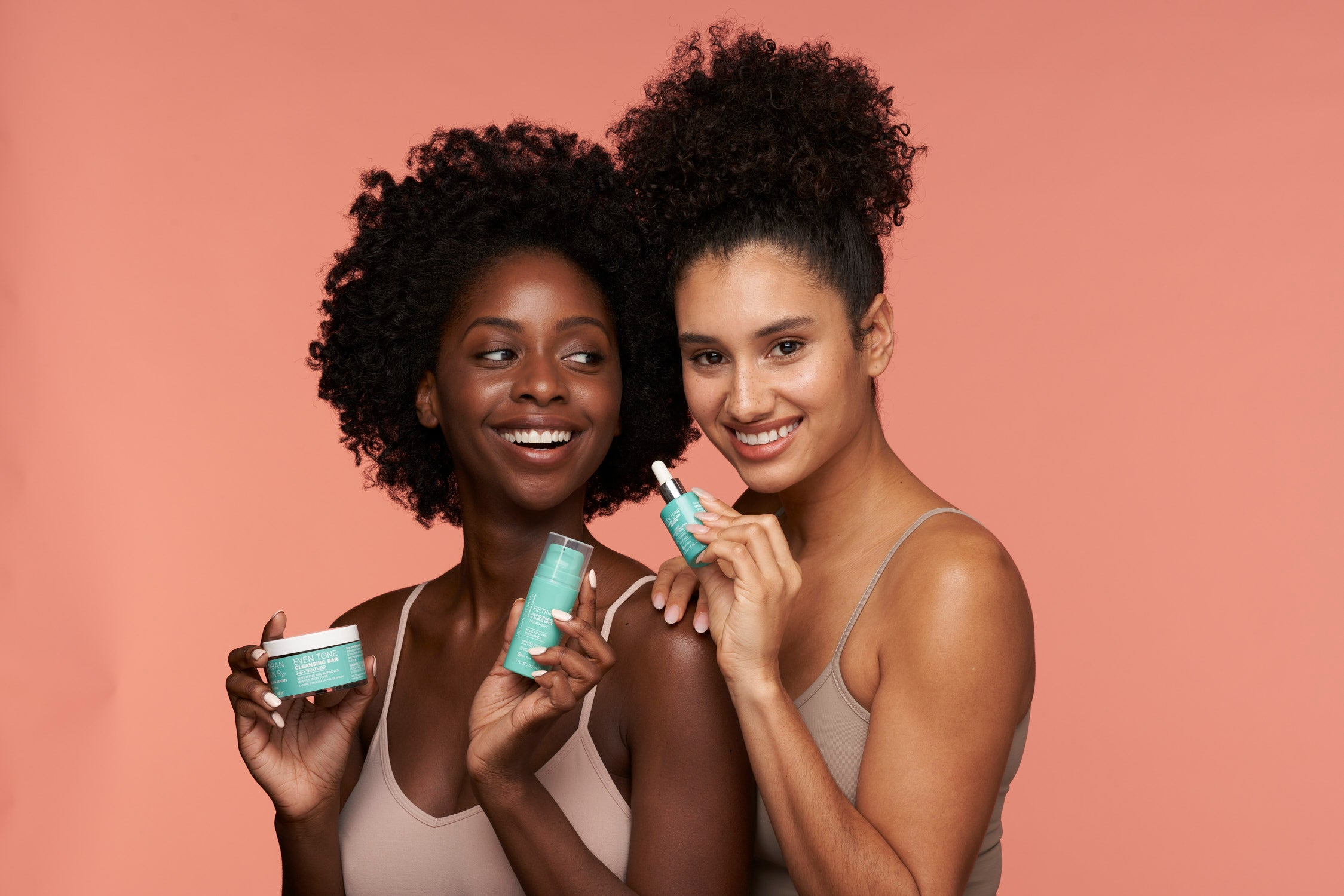 Two African American Women holding Skincare Products