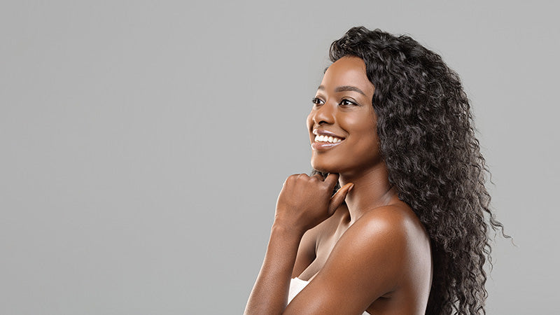 beautiful african american woman smiling with glowing skin