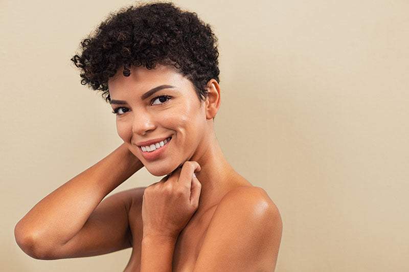 beautiful african american woman smiling after skin treatment