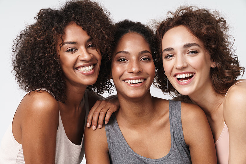 multi-racial women smiling