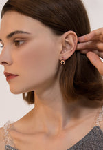 Orla with Round Roman Numeral Rose Gold Huggie Hoop Earrings