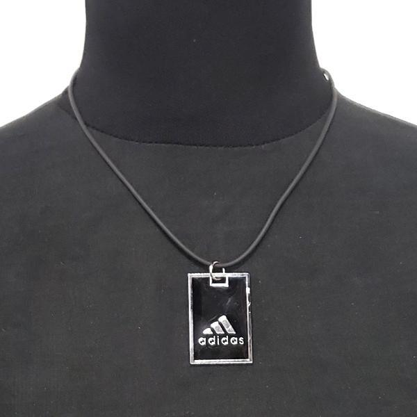 Silver Plated Adidas Pendant On A Black Nylon Chain