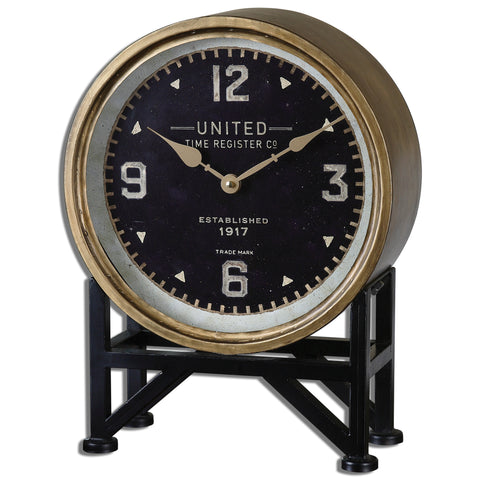 Clock face features a metal frame with a brass finish and aged black stand.