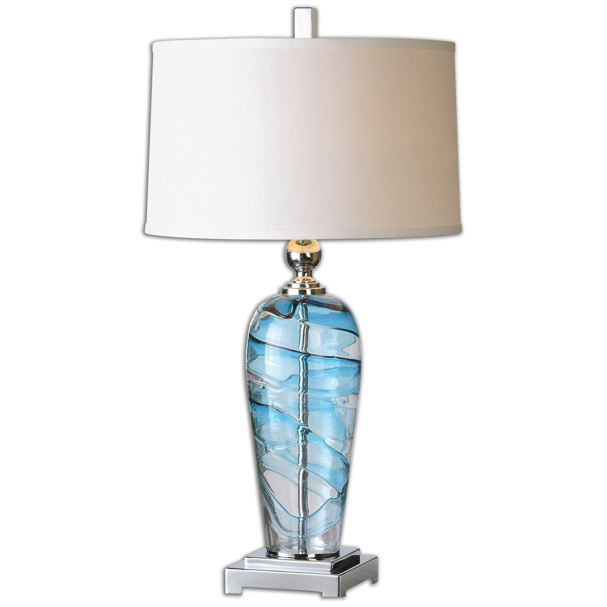 Blown, clear and blue glass accented with polished nickel plated details. The slightly tapered round hardback shade is a crisp white linen fabric.