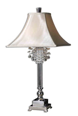 Table lamp features silver plated metal with crystal accents and silken champagne fabric on the shade.
