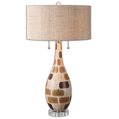 Table lamp with ceramic base finished in a patchwork of glazes consisting of aged ivory, rust beige, browns, and dark bronze with polished nickel plated accents and crystal details. The round hardback drum shade is a rust burlap fabric.