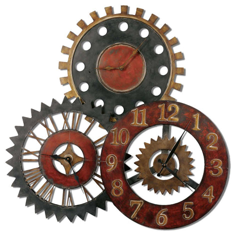 This unusual collage of clocks is made from hand forged metal and features a finish of vibrant rustic red, antiqued gold and aged black.