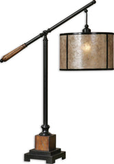 Aged black metal accented with solid wood details finished in a heavily distressed rustic mahogany and a light rottenstone glaze. The round drum shade is made of natural mica with aged black trim.