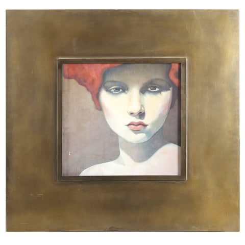 Portrait of a caucasion redheaded woman looking directly at you. Framed in a wide bronze metal.