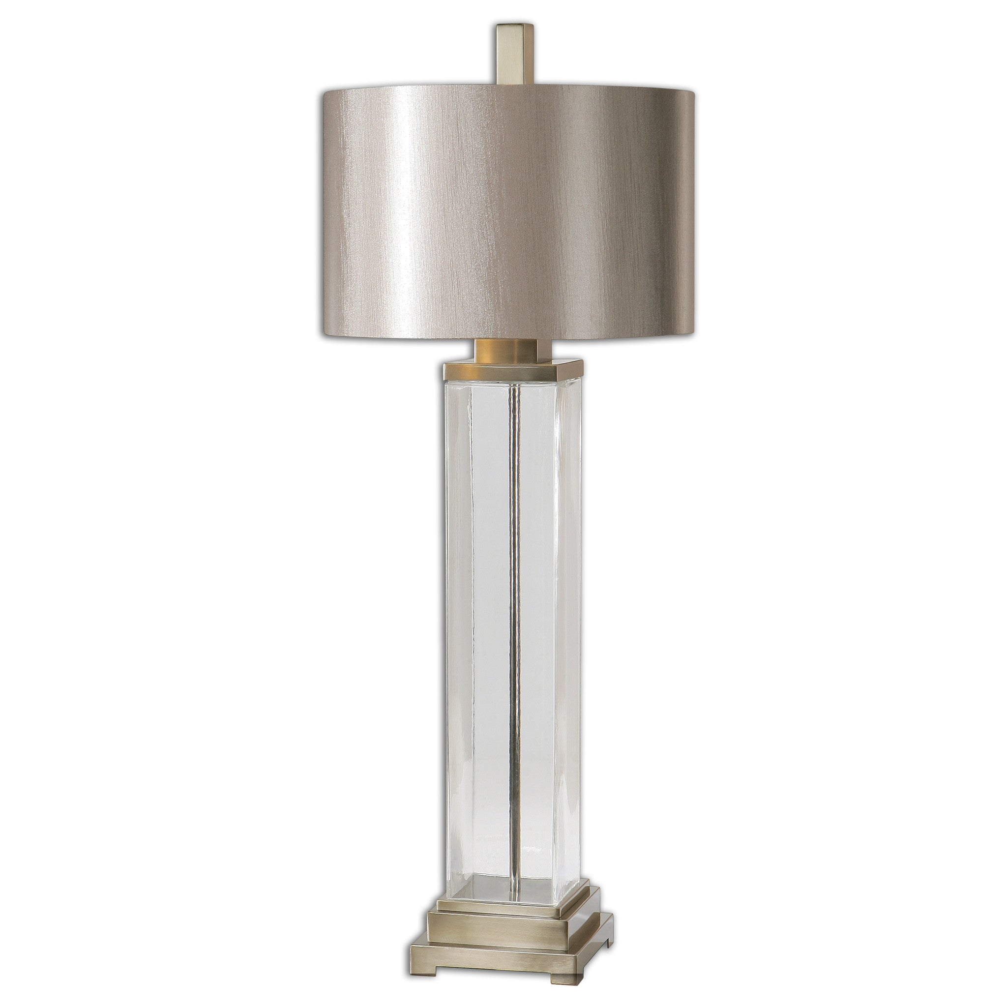 Thick clear glass accented with brushed nickel plated details. The round hardback drum shade is a silken champagne bronze fabric.