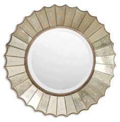 Round mirror in center, with antique gold leaf mirrored edges