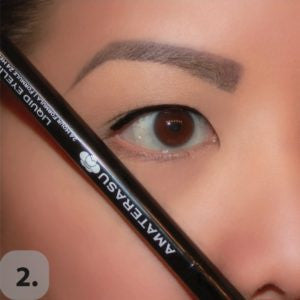 Take a straight edge such as the eyeliner or brush handle, and angle it against your nose, pointing towards the end of your eyebrow. This will be the angle of your wing.