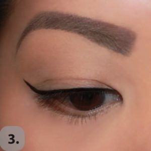 Starting where the eyeliner ends on the outer corner of your eyelid, draw a line up towards the tail of your eyebrow, using step 2 as guidance. The length of the line you draw will determine how dramatic your cat eye will be. The longer the line, the more dramatic it will be.