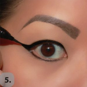 Fill in the empty space, creating the wing and draw a line along the lower lash line as close to the lashes as possible.