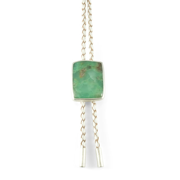 nishnabotna silver bolo tie with green chyrsoprase on white leather cord