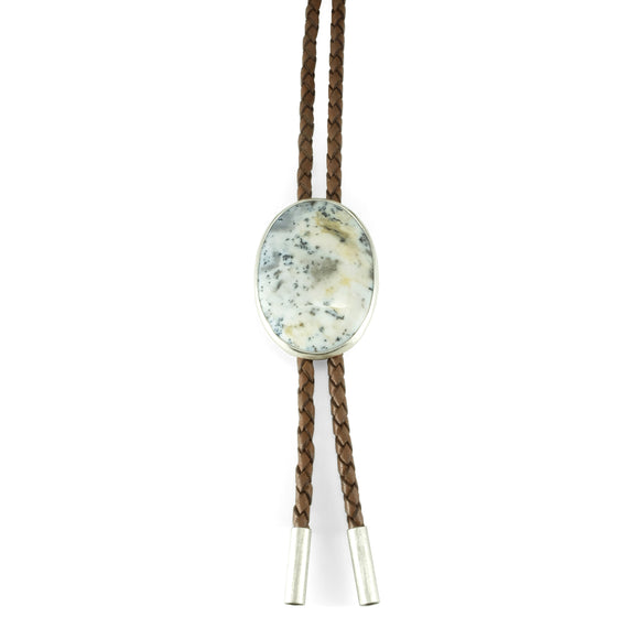 nishnabotna silver bolo tie with black and white dendritic agate on brown leather cord
