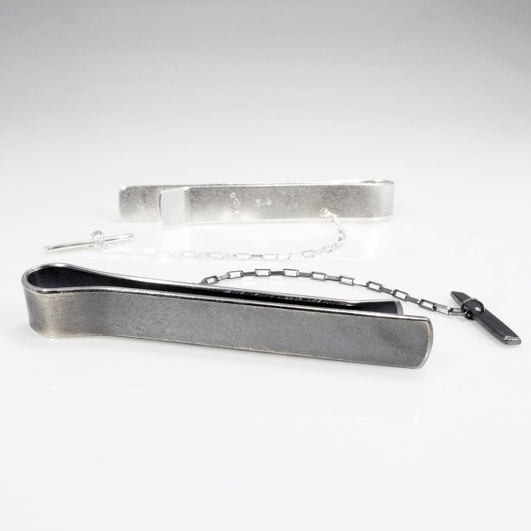 Sterling silver tie bar in black oxidized and brushed silver finish.