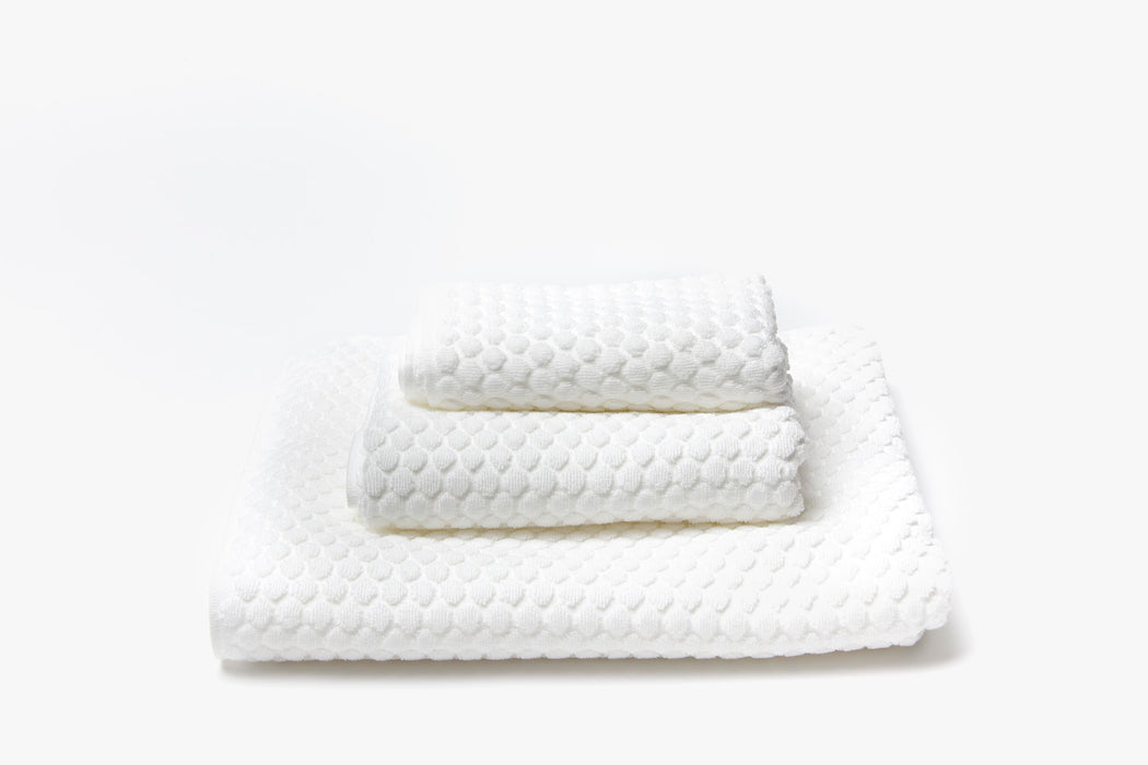 Morihata Puchi Puchi Hand Towel - White - hand towel piled up between washcloth and bath towel