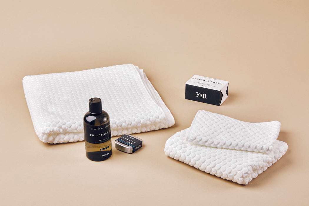 Morihata Puchi Puchi Hand Towel - White - hand towel, washcloth, and bath towel laying next to Fulton & Roark grooming products