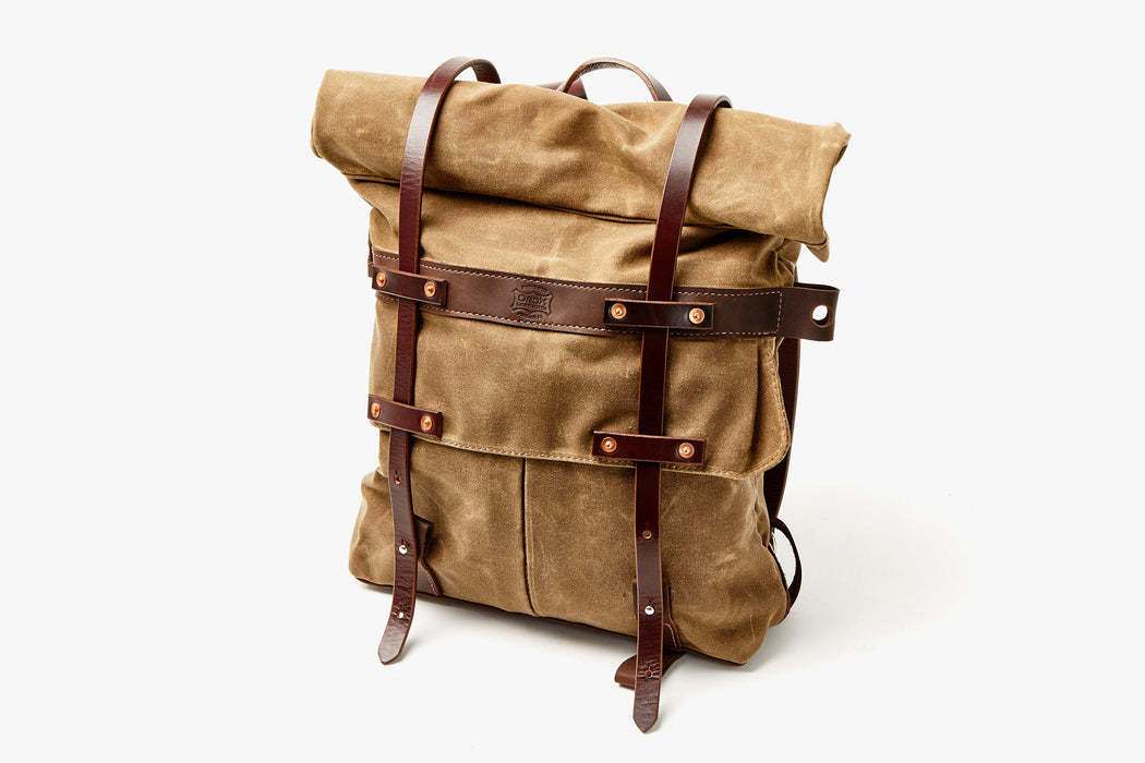 Orox Leather Co. Parva Rucksack - Brown - diagonal view of bag standing up