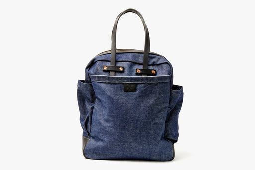 Orox Leather Co. Viator Carryall Bag- Denim - front view of bag standing up with handles facing up