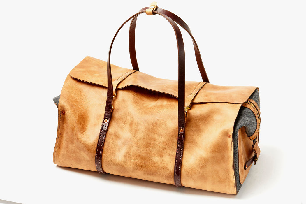 Orox Leather Co. Ryoko Duffel - Sand - diagonal view of bag standing up with handles facing up
