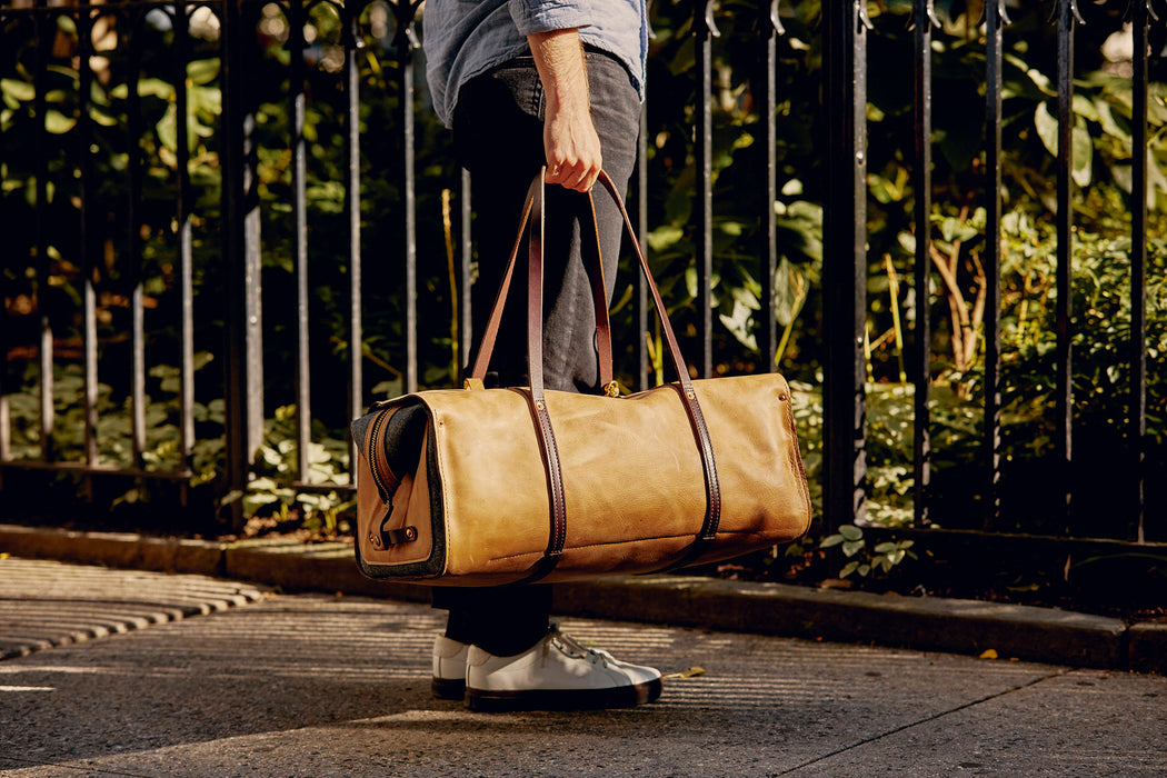 Orox Leather Co. Ryoko Duffel - Sand - man holding the duffel on a sidewalk