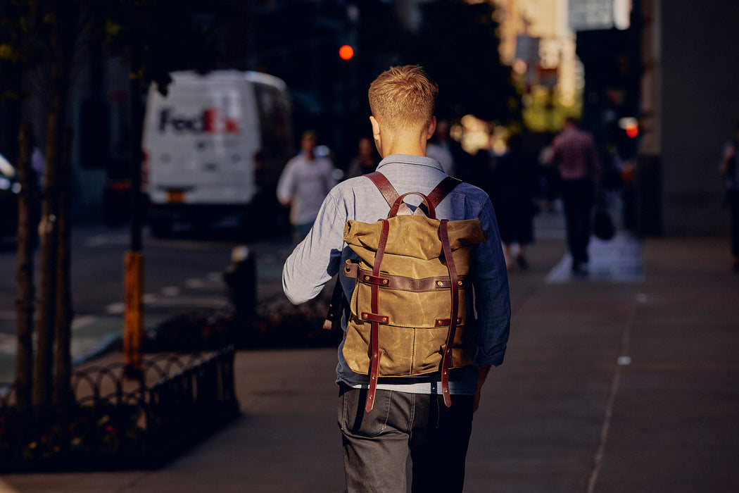 Orox Leather Co. Parva Rucksack - Brown - image of man walking down the street wearing the backpack