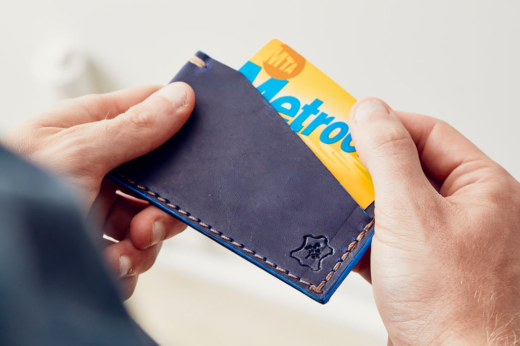 Orox Leather Co. Slim Cardholder - Sapphire - man taking a MetroCard out of the cardholder