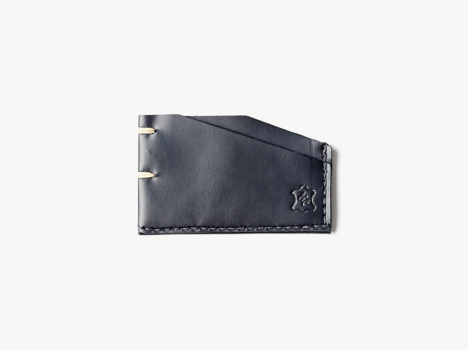 Orox Leather Co. Slim Cardholder - Black - top-down view of cardholder on a white surface
