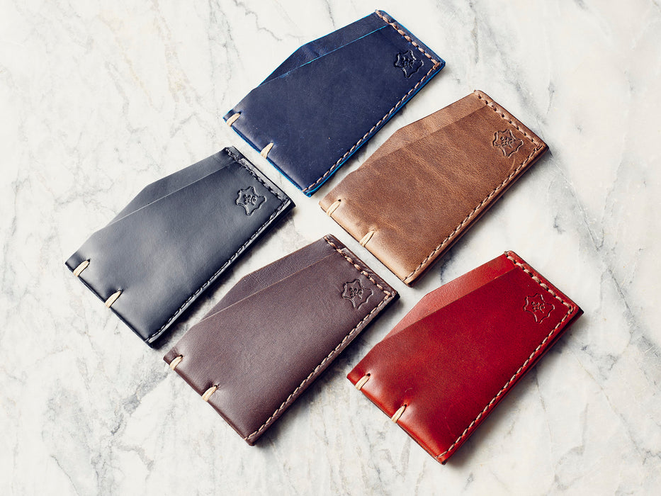 Orox Leather Co. Slim Cardholder - five different-colored cardholders laying in a grid on a marble surface