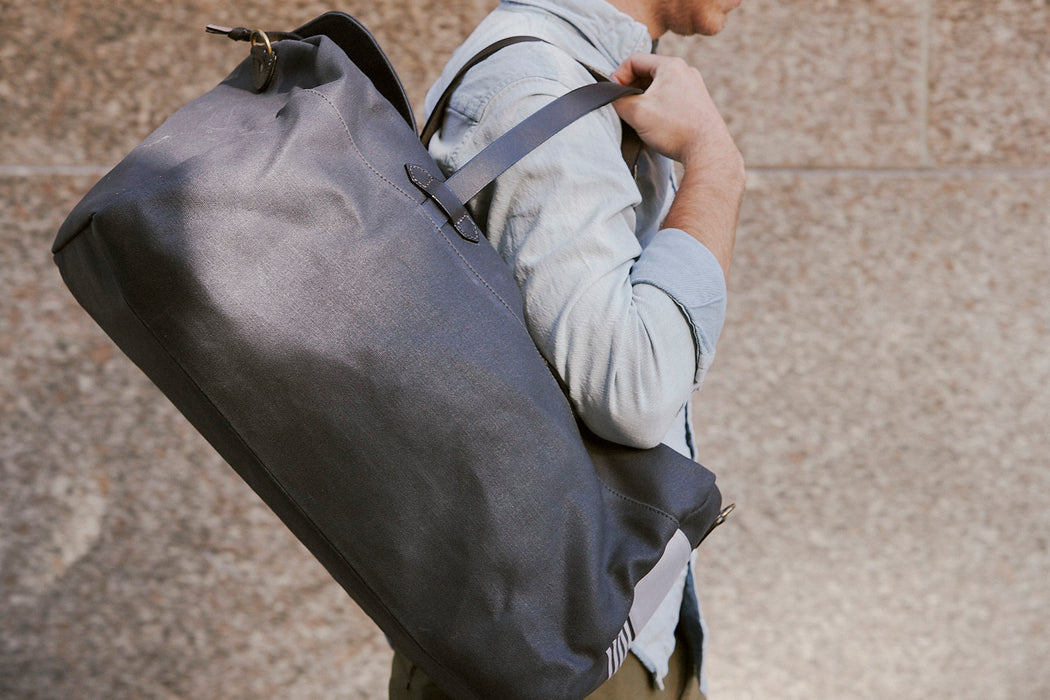 Long Wharf Supply Co. Ipswich Weekender Bag - Navy - man holding the duffel over his shoulder