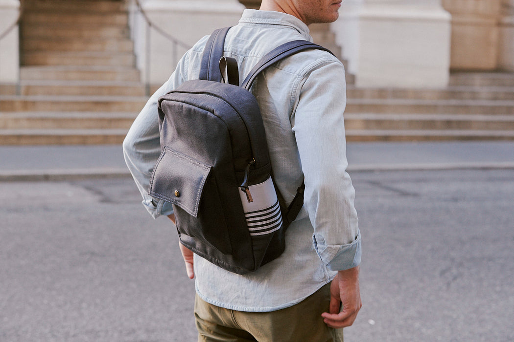 Long Wharf Supply Co. Ipswich Day Backpack - Navy - side view of man wearing backpack
