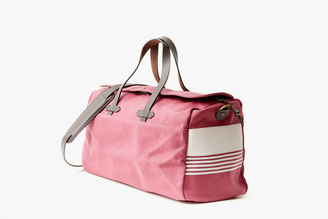 Long Wharf Supply Co. Ipswich Weekender Bag - Maroon - side view of duffel standing upright, showing top handles and shoulder strap