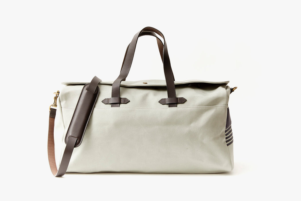 Long Wharf Supply Co. Ipswich Weekender Bag - Grey - front view of duffel standing upright, showing top handles and shoulder strap