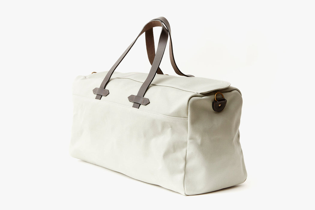 Long Wharf Supply Co. Ipswich Weekender Bag - Grey - side view of duffel standing upright, showing top handles