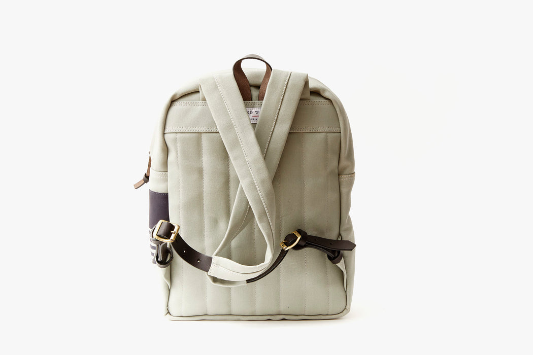 Grey Long Wharf Supply Co. Ipswich Day Backpack - Grey - back view showing straps cross-crossed and also showing leather detailing