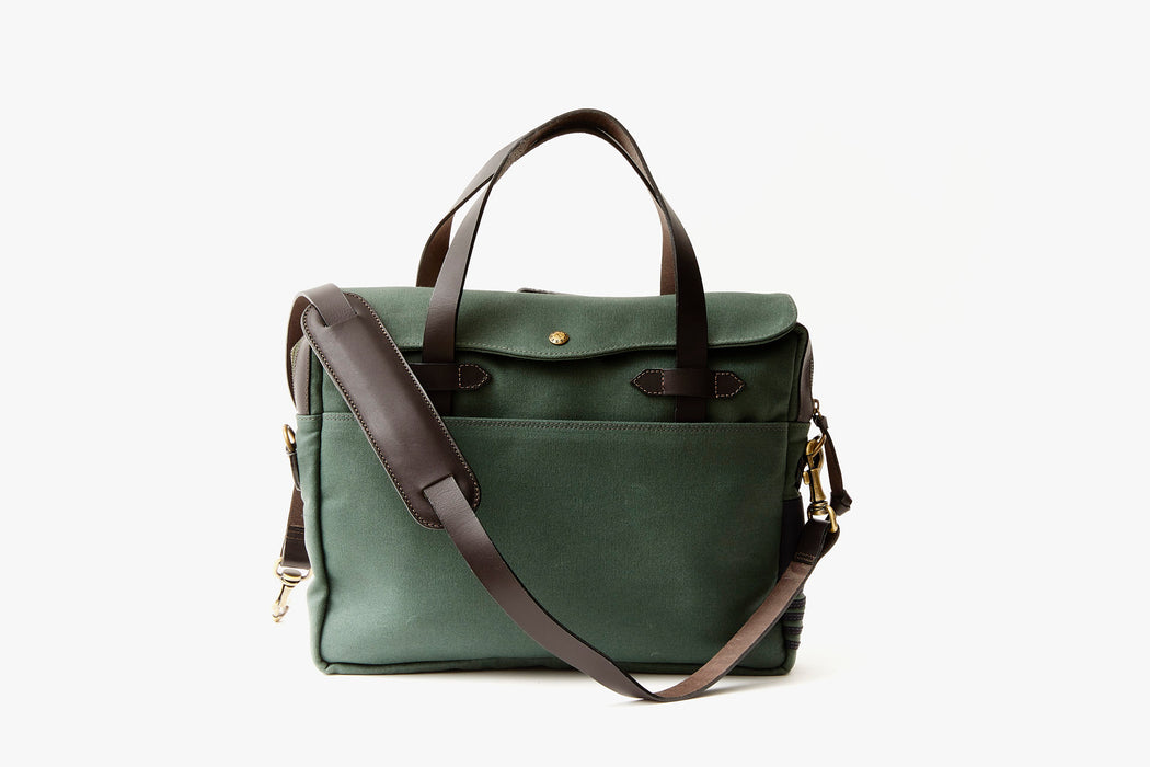 Long Wharf Supply Co. Newport Briefcase - Pine - green briefcase standing up, showing brown leather detailing, straps, and gold hardware