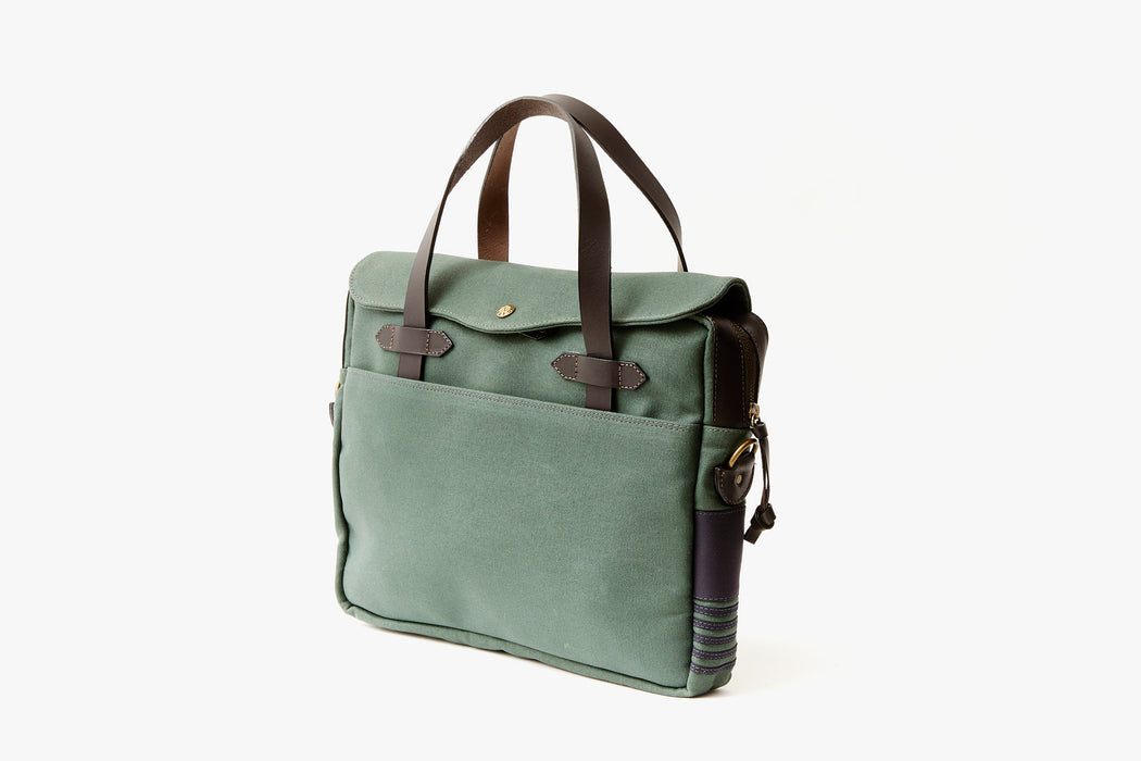 Long Wharf Supply Co. Newport Briefcase - Pine - side view of green briefcase standing up, showing brown leather detailing on side panel