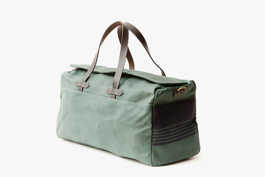 Long Wharf Supply Co. Ipswich Weekender Bag - Pine - side view of duffel standing upright, showing top handles