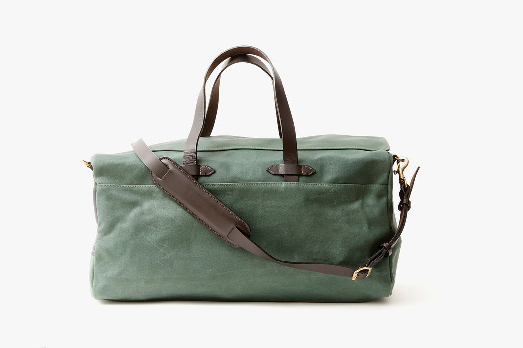 Long Wharf Supply Co. Ipswich Weekender Bag - Pine - front view of duffel standing upright, showing top handles and shoulder strap