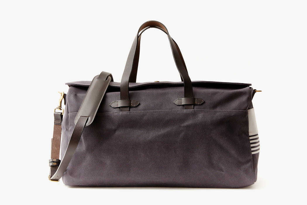 Long Wharf Supply Co. Ipswich Weekender Bag - Navy  - front view of duffel standing upright showing top handles and shoulder strap