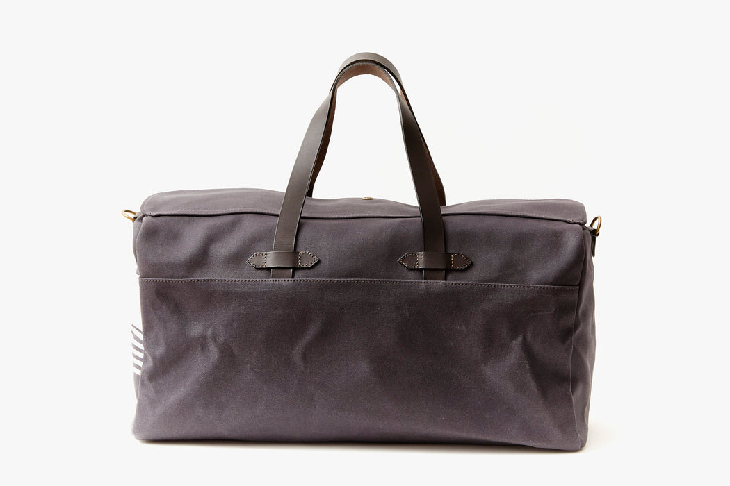 Long Wharf Supply Co. Ipswich Weekender Bag - Navy  - side view of duffel standing upright showing top handles