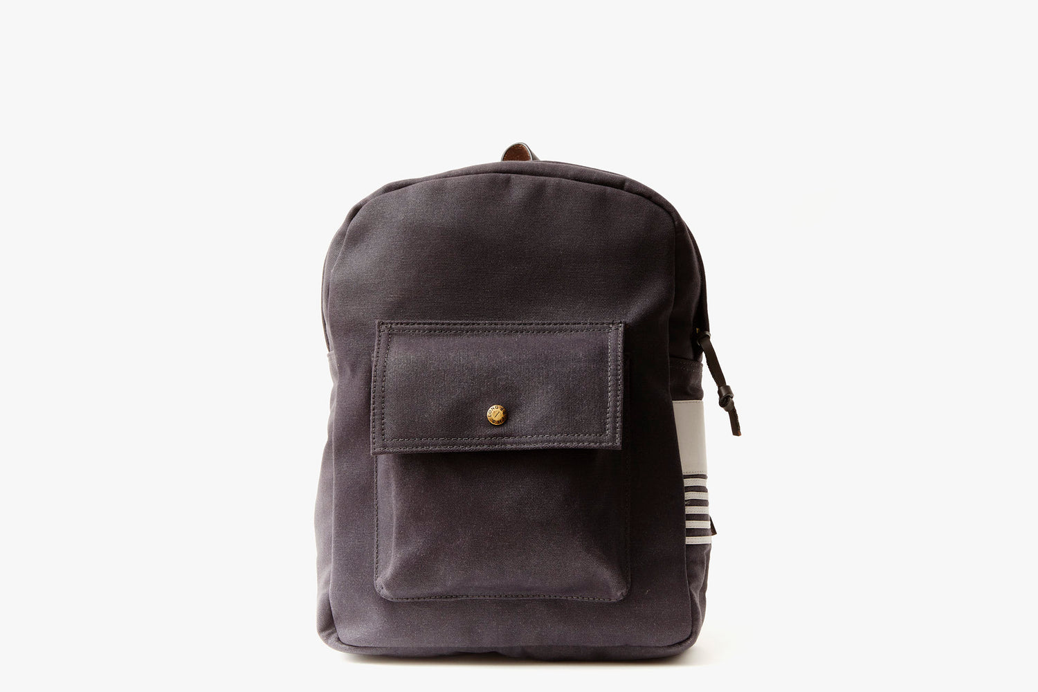 Navy Long Wharf Supply Co. Ipswich Day Backpack - Navy - image of backpack standing up, showing front pocket detail and gold-toned snap closure