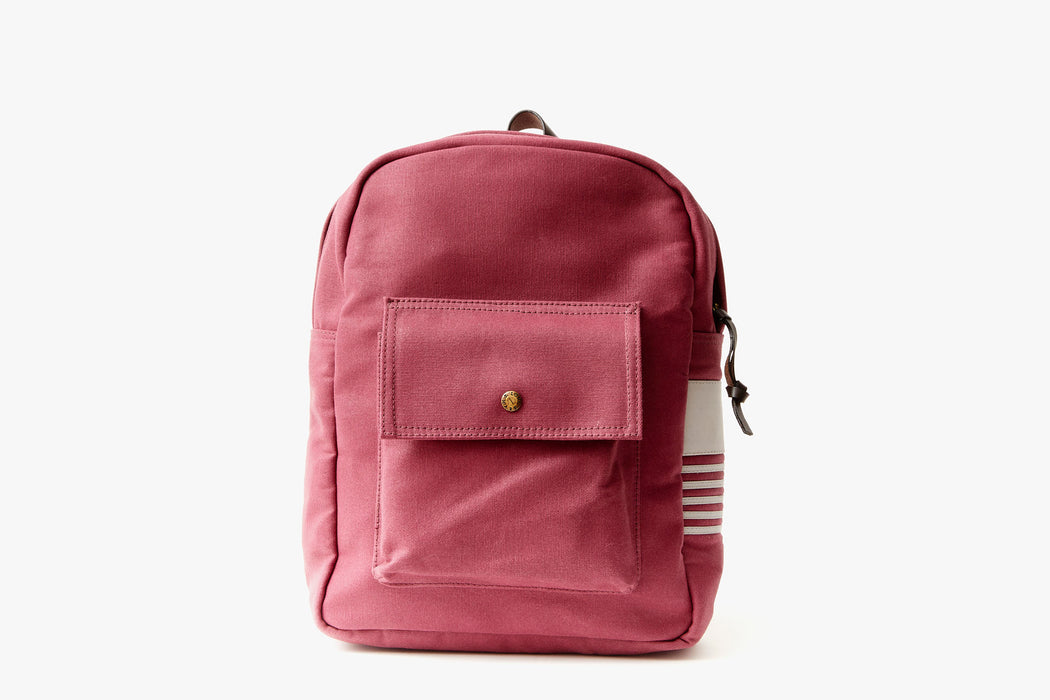 Maroon Long Wharf Supply Co. Ipswich Day Backpack - Maroon - front view of backpack standing up, showing front pocket with a gold-toned snap closure