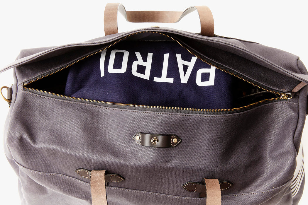 Long Wharf Supply Co. Ipswich Weekender Bag -Navy - unzipped duffel showing sweatshirt in interior