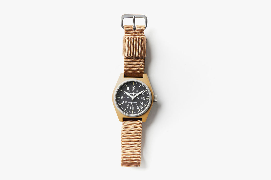 Marathon General Purpose Quartz Composite Watch With Date - Desert Tan - Top-down image of watch laying flat