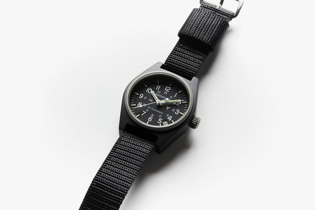 Marathon General Purpose Quartz Composite Watch - Black - Side view of watch laying flat